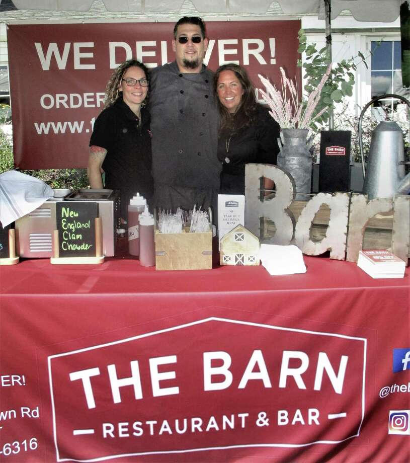 The Barn, the newest business in Morris, was welcomed by Ben Paletsky of Morris Economic Development Commission, at Savor Litchfield. Photo: Jo Ann Jaacks / For Hearst Media CT