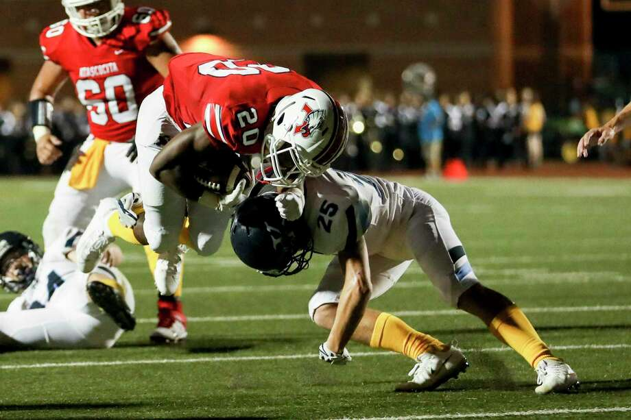 Kingwood Mustangs Robert McCall (25) tackles Atascocita Eagles Tyras Winfield (20) on Friday night at Turner Stadium. Photo: Katelyn Mulcahy, Houston Chronicle / Contributor / © 2019 Houston Chronicle