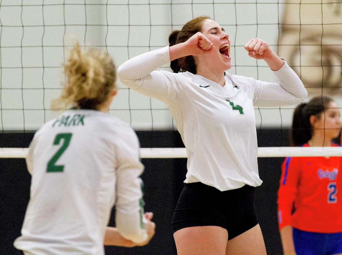 Kingwood Park outside hitter Elizabeth Overmyer (4) reacts after scoring a point during the first set of a District 20-5A high school volleyball match at Kingwood Park High School, Tuesday, Sept. 10, 2019, in Kingwood.