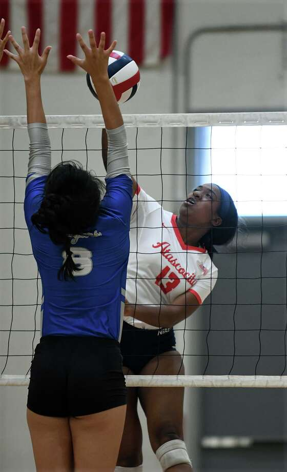 Atascocita senior outside hitter Zaire Miles (13) works at the net against Cy Creek middle blocker Kat Betancourt (8) during their CCISD Varsity Volleyball Tournament Copper Bracket matchup at Clear Brook High School on August 31, 2019. Photo: Jerry Baker, Houston Chronicle / Contributor / Houston Chronicle