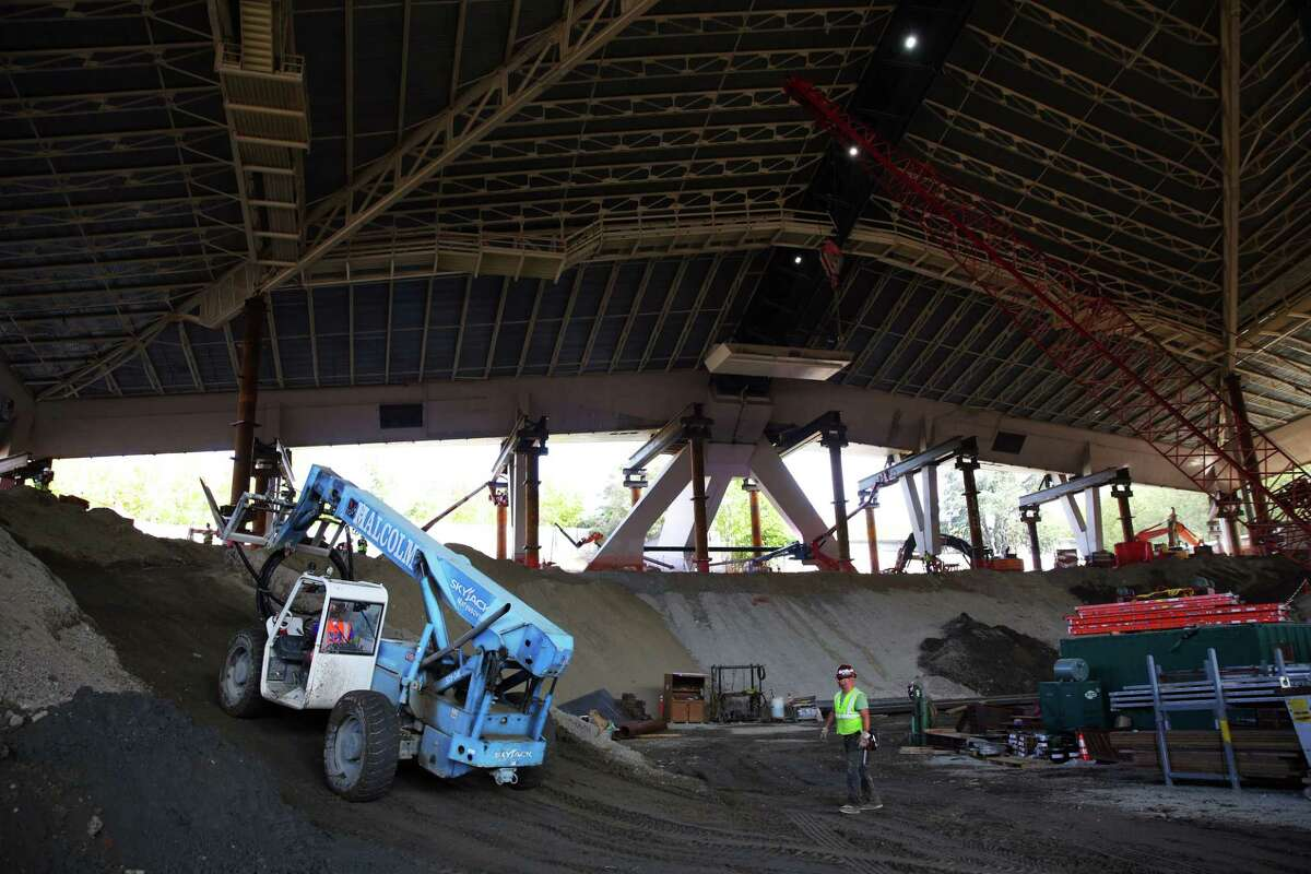 Construction continues on the new arena at Seattle Center, Monday, Sept. 16, 2019. The 44-million pound roof of the arena is suspended as the new arena is built underneath.