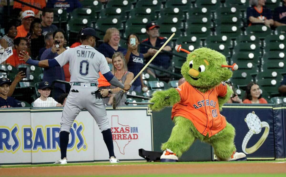 Seattle Mariners' Mallex Smith (0) has some fun with Houston Astros mascot Orbit before a baseball game Friday, Sept. 6, 2019, in Houston. (AP Photo/David J. Phillip)