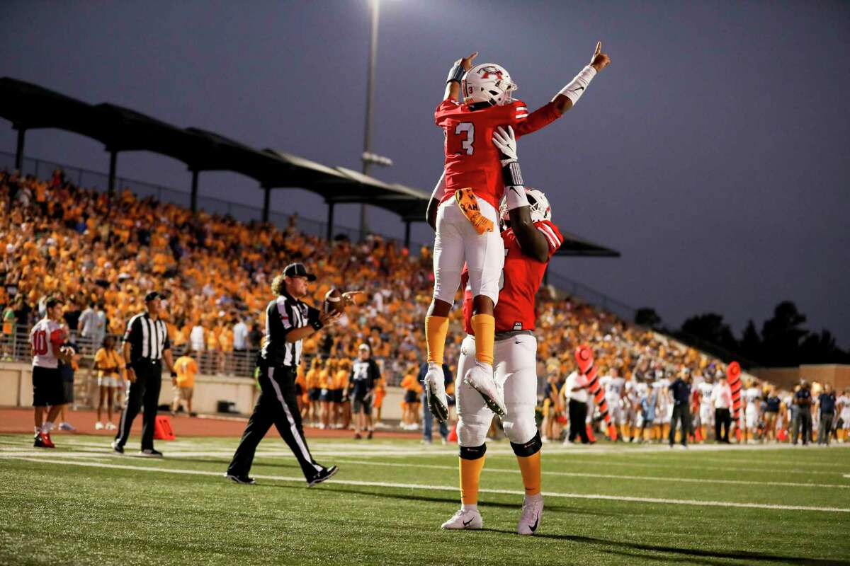 Atascocita Eagles quarterback Brice Matthews (3) celebrates a touchdown with Atascocita Eagles Kameron Dewberry (75) during a conference football game between the Kingwood Mustangs and the Atascocita Eagles on Friday, September 13, 2019 at Turner Stadium, Humble, TX.