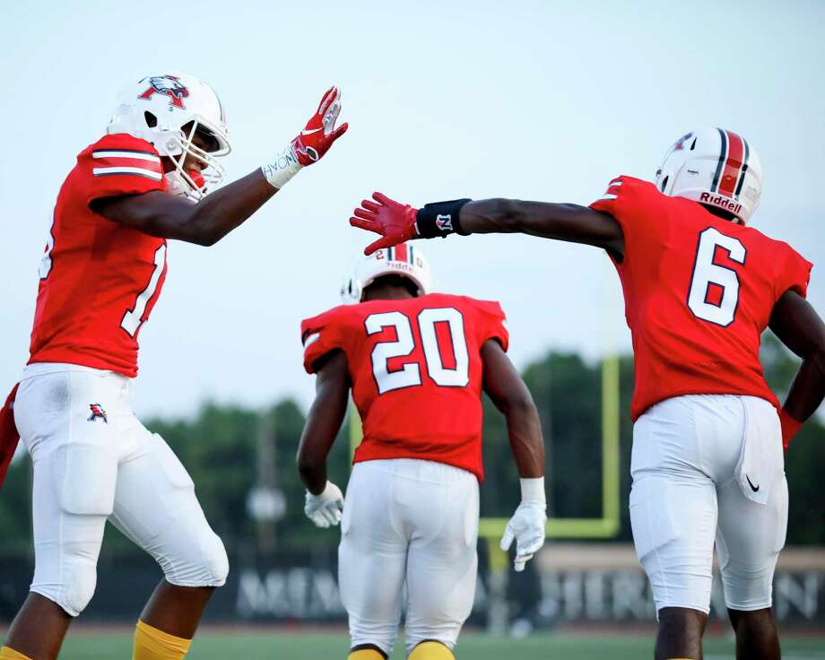 Atascocita Eagles Landen King (13) celebrates a touchdown with Atascocita Eagles A.J. Bobb (6) during a conference football game between the Kingwood Mustangs and the Atascocita Eagles on Friday, September 13, 2019 at Turner Stadium, Humble, TX. Photo: Katelyn Mulcahy, Houston Chronicle / Contributor / © 2019 Houston Chronicle