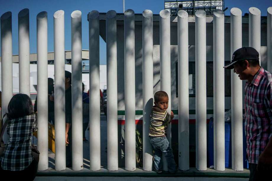 A young migrant from Honduras waits in line with his parents at the Mexico-United States border in Tijuana, Mexico on Sept. 12, 2019. Photo: Sandy Huffaker /Getty Images / AFP or licensors