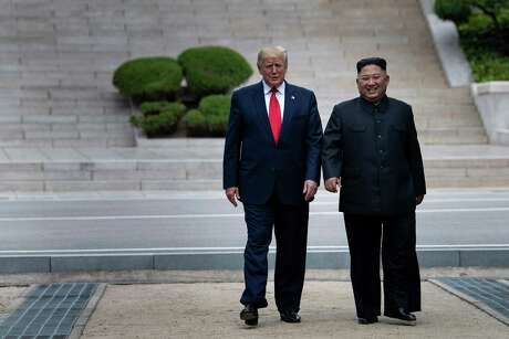 President Donald Trump and North Korea's leader Kim Jong-un walk on North Korean soil toward South Korea in the Demilitarized Zone earlier this year. Trump is drawn to deals with despots because that would make the deal extra epic — even if, you know, it's not a good deal.