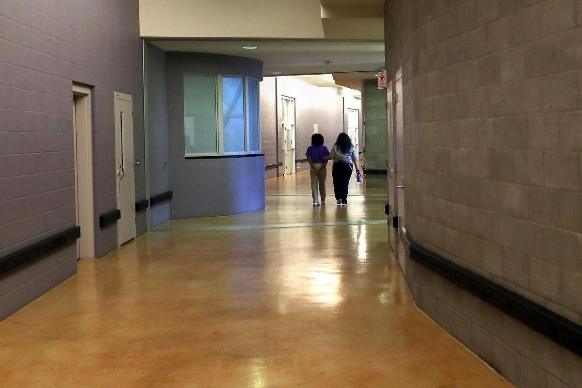 A juvenile is led back to her unit at Juvenile Hall in San Francisco, Calif. on Thursday, September 20, 2018.