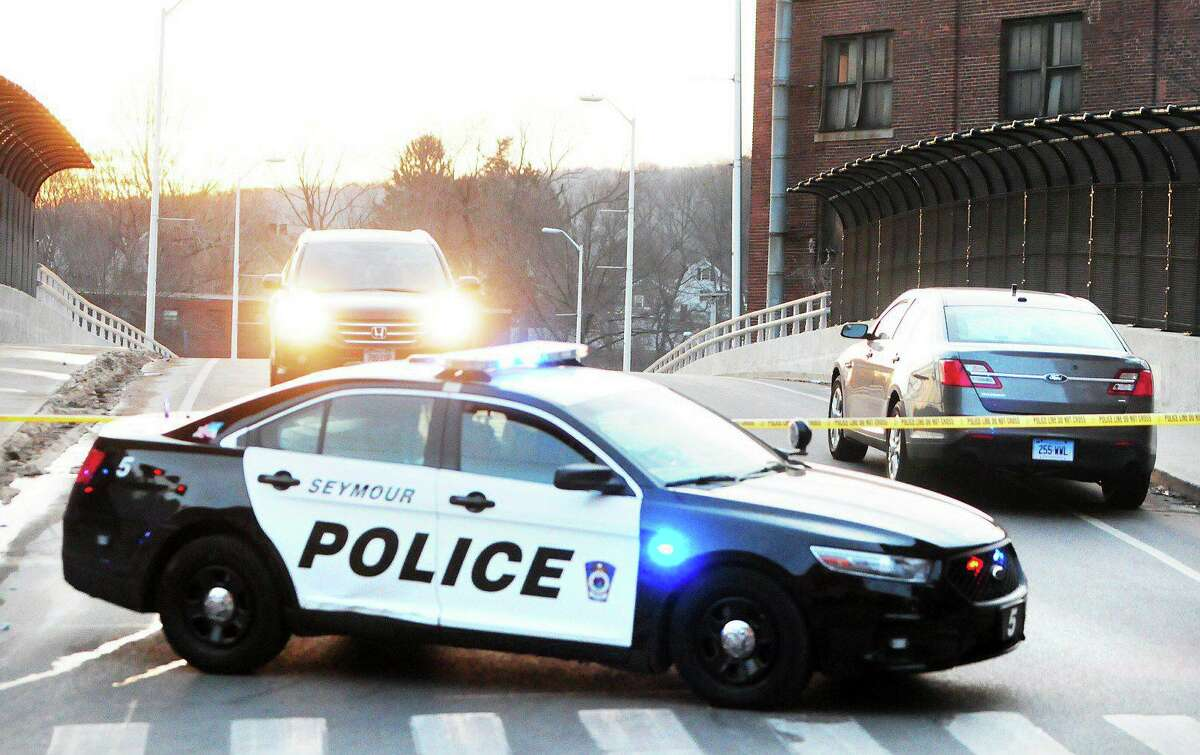 (Peter Hvizdak ? New Haven Register) Police close off Maple Ave. in Ansonia on 2/1/2014.