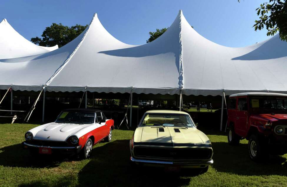 Vehicles are parking in advance of the upcoming Saratoga Auto Auction at the Saratoga Performing Arts Center grounds on Monday, Sept.16, 2019, at Saratoga Spa State Park in Saratoga Springs, N.Y. Sales take place Friday and Saturday at SPAC, where buyers can bid on more than 300 vehicles, according to organizers. It is held in support of and presented by the Saratoga Automobile Museum. (Will Waldron/Times Union)