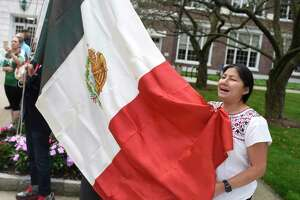 Greenwich's Consuelo Cid sings the Mexican National Anthem during the Mexican Independence Day flag-raising ceremony at Town Hall in Greenwich, Conn. Monday, Sept. 16, 2019. With many Mexican-American Greenwich residents in attendance, the town celebrated its Mexican heritage and influence with a flag-raising and playing of the Mexican National Anthem.
