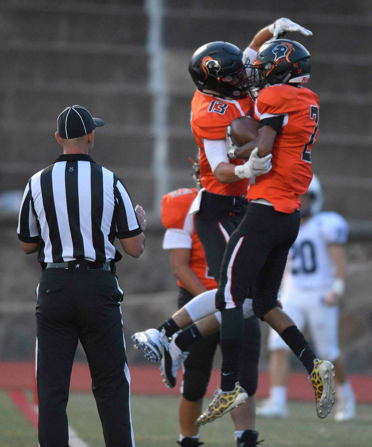 Stamford's Tyriq Deveaux (2) celebrates his touchdown against Staples in the first quarter on Friday.