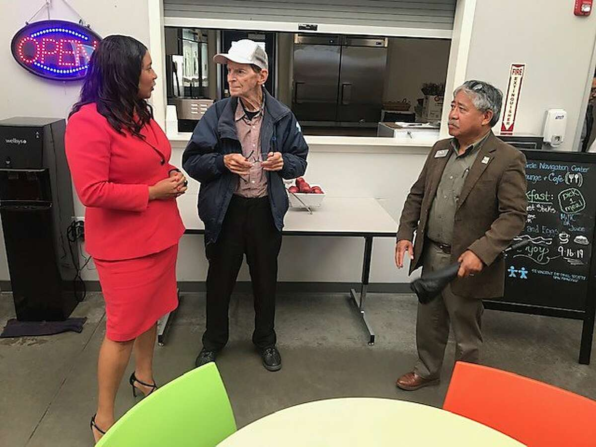 Mayor London Breed and Vallejo Mayor Bob Sampayan meet with Paul Forbes, who is staying at the Division Circle Navigation Center in the Mission District. The center added 60 new beds on Monday, Sept. 16, 2019.