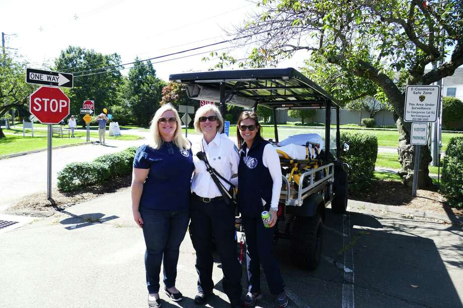EMTs Kelly Daniel, Debbie Fasano and Niki Morton stood by a mobile stretcher at the EMS open house on Sunday, Sept. 15. Photo: Grace Duffield / Hearst Connecticut Media