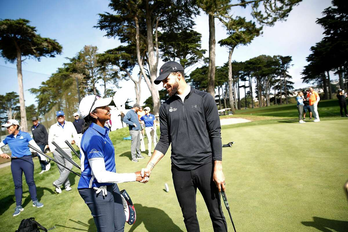 Warriors guard Stephen Curry (right) talks with former U.S. Secretary of State Condoleezza Rice during the skills challenge at the Steph Curry Charity Classic at Harding Park on Sept. 16, 2019.