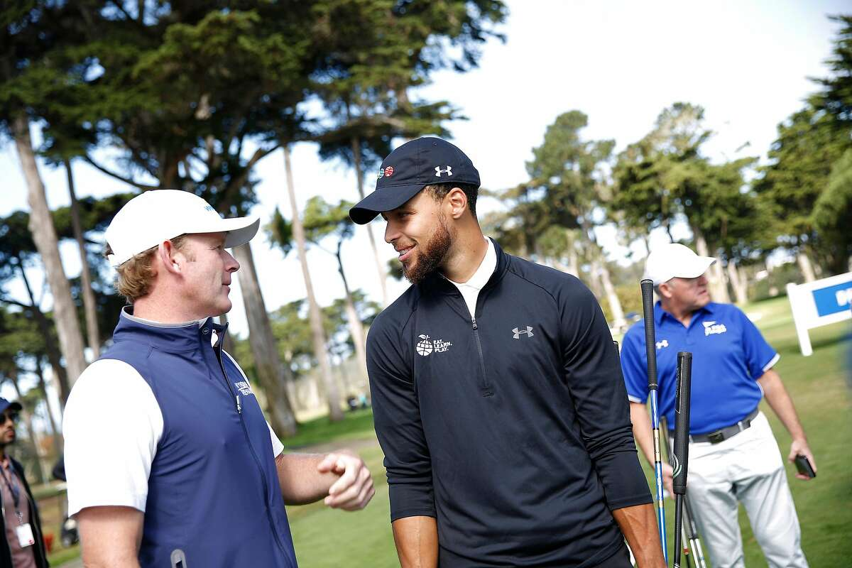 Stephen Curry (right), Golden State Warriors guard, talks with professional golfer Brandt Snedeker (left) during the skills challenge at the Steph Curry Charity Classic at Harding Park Golf Course on Monday, September 16, 2019 in San Francisco, CA.