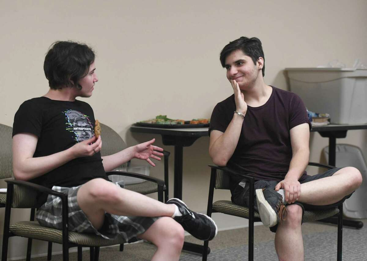 """Damian Daher, left, 20, and Jake Pavia, 22, chat during the Kids in Crisis Lighthouse LBGTQ+ meeting at the Tully Health Center in Stamford last week. Lighthouse announced a new speaker series """"Queer & Questioning: A Community Forum"""" that will be held four times a year in the Harry Bennett Branch Library. The first event is themed """"Protecting LGBTQ Youth: What Are the Laws and Where Are We Now?"""" and will feature a panel of State Rep. Matt Blumenthal, State Rep. Jeff Currey and Stamford Board of Education President Andy George on Sept. 18 at 7 p.m."""
