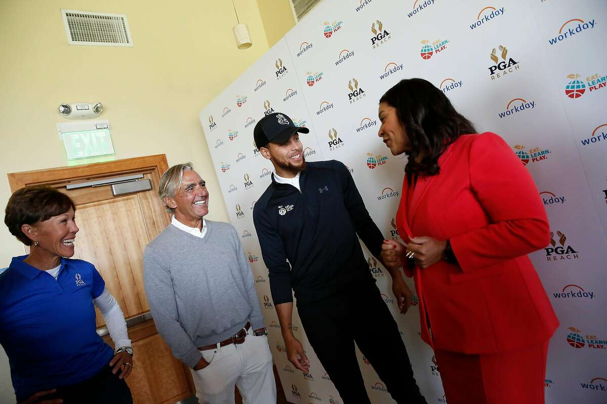 Stephen Curry (second from right), Golden State Warriors guard, talks with Mayor London Breed (right), Seth Waugh (second from left) , CEO of PGA of America; and Suzy Whaley (left), president of PGA of America, at the Steph Curry Charity Classic at Harding Park Golf Course on Monday, September 16, 2019 in San Francisco, CA.