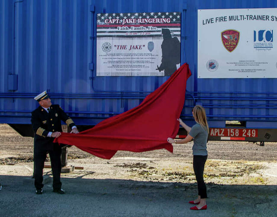 """Family members, local officials and many area firefighters were on hand Sept. 7 to commemorate fallen Godfrey firefighter Jake Ringering with the dedication of """"The Jake,"""" a live-fire multi-trainer system. The dedication included a series of demonstrations and tours through the unit."""