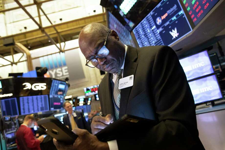 John Wilson, with the New York Stock Exchange, monitors stock activity, Monday, Sept. 16, 2019. Global stock markets sank Monday after crude prices surged following an attack on Saudi Arabia's biggest oil processing facility. (AP Photo/Mark Lennihan) Photo: Mark Lennihan / Copyright 2019 The Associated Press. All rights reserved