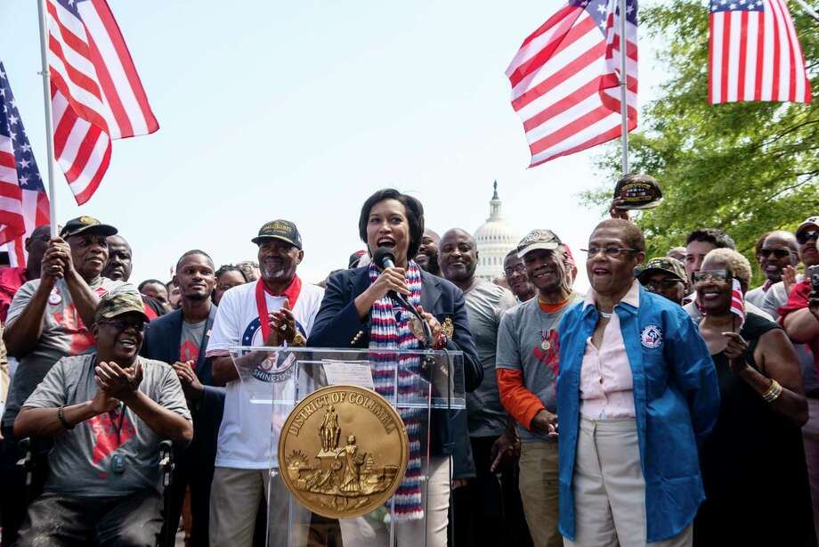 District of Columbia Mayor Muriel Bowser, flanked by Del. Eleanor Holmes Norton, far right, and 51 veterans, call for D.C. statehood. Photo: Washington Post Photo By Marvin Joseph / The Washington Post
