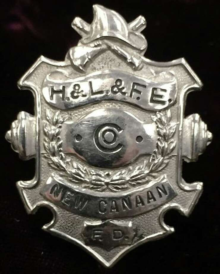 A firefighter's badge from days gone by is part of an exhibit reflecting on the history of New Canaan Fire Company No. 1, opening at the New Canaan Museum and Historical Society on Oct. 1. Contibuted photo / New Canaan Museum Photo: Contributed Photo / New Canaan Museum / New Canaan Advertiser Contributed