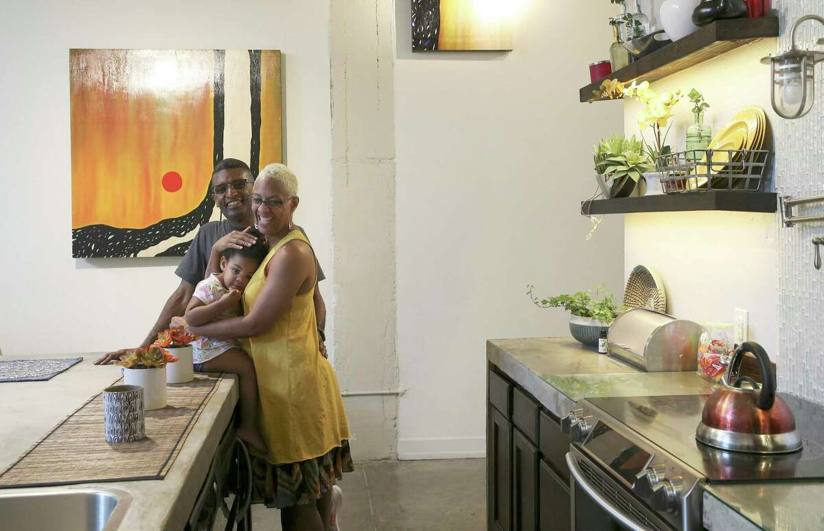 Rodney and Latonya Gaither (pictured with their granddaughter Sanaya Hand) recently sold their home near Camp Bullis and downsized to move to an apartment in the Steelhouse Lofts on South Flores Street.