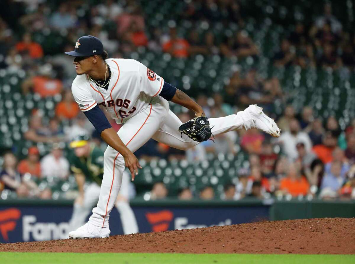 Houston Astros relief pitcher Bryan Abreu (66) pitches during the ninth inning of a MLB baseball game at Minute Maid Park, Wednesday, Sept. 11, 2019, in Houston.