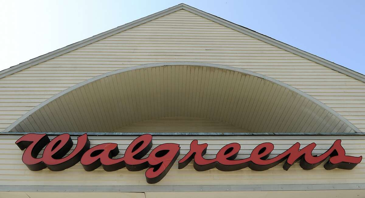 FILE - This Sept. 28, 2009, file photo, shows a sign above a Walgreens entrance in Gloucester, Mass. Drug chains CVS and Walgreens, as well as grocery chain Wegmans Food Market, have joined the chorus of retailers requesting that customers refrain from openly carrying firearms in their stores even where state laws allow it. (AP Photo/Lisa Poole, File)