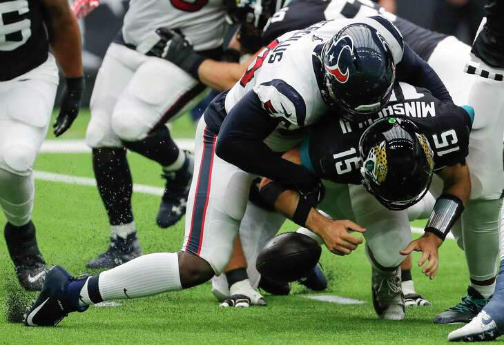 Linebacker Whitney Mercilus forces a fumble by Jaguars quarterback Gardner Minshew that gave the Texans a short field for their only touchdown Sunday.