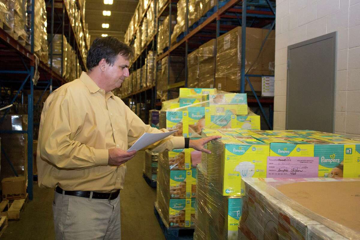 Brian Greene, president and CEO of the Houston Food Bank checks donations following Hurricane Harvey.