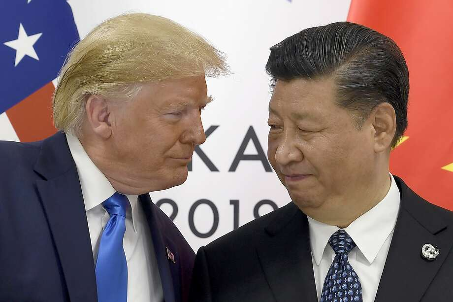 FILE - In this June 29, 2019, file photo, President Donald Trump, left, meets with Chinese President Xi Jinping during a meeting on the sidelines of the G-20 summit in Osaka, Japan. Photo: Susan Walsh, Associated Press