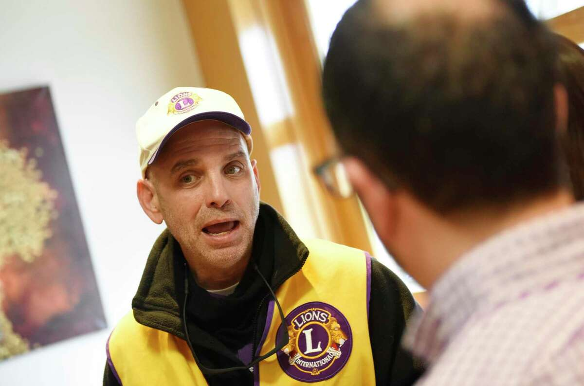 Cos Cob resident Alan Gunzburg, who is legally blind, speaks at the Lions Club of Greenwich eye examination session at Temple Sholom in Greenwich, Conn. Monday, Jan. 23, 2017.