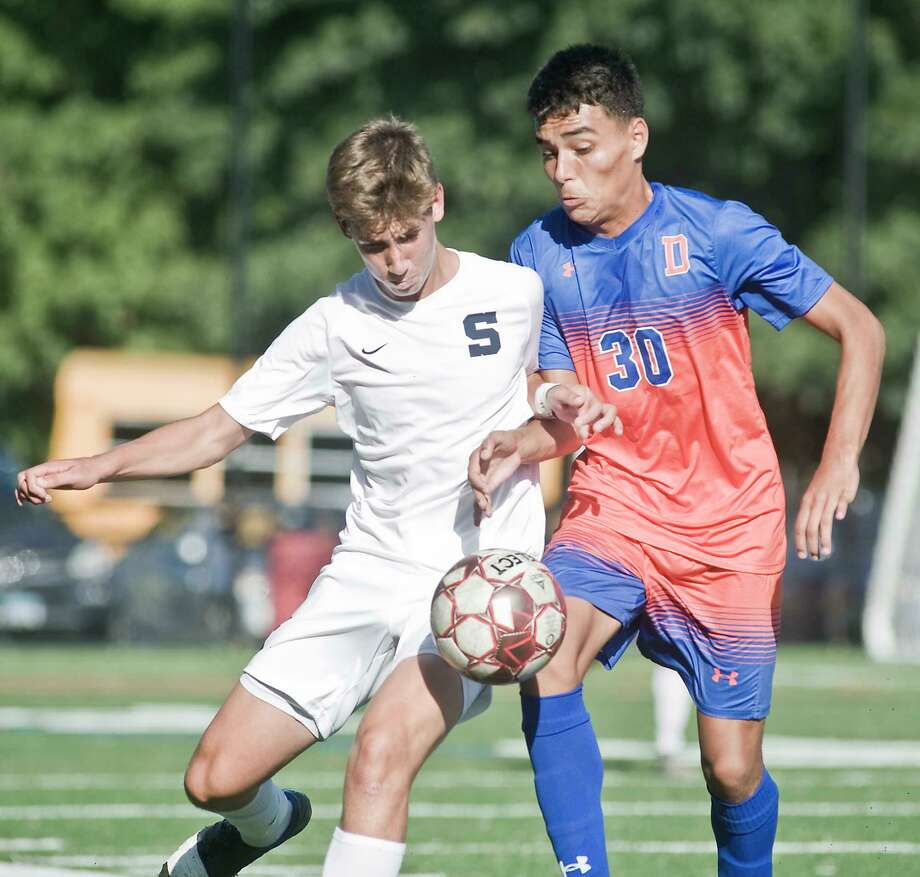 Staples High School's Benjamin Feuer and Danbury High School's Christofer Carrasco push each other in a game played at Mill Ridge School in Danbury. Monday, Sept. 16, 2019 Photo: Scott Mullin / For Hearst Connecticut Media / The News-Times Freelance
