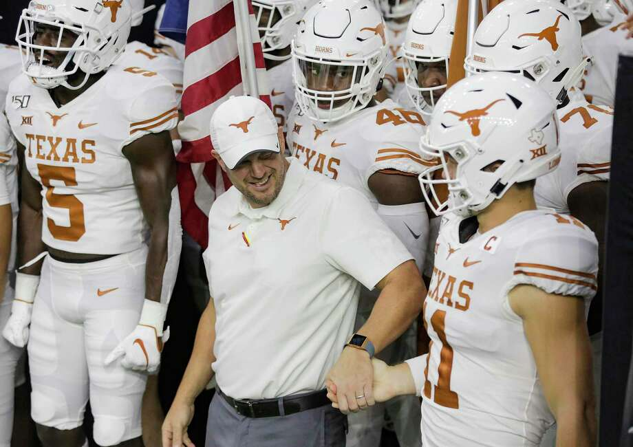 Texas coach Tom Herman, center, hired Chris Ash as his new defensive coordinator, and hired Ohio State assistant Mike Yurcich as his new offensive coordinator. Photo: Elizabeth Conley, Houston Chronicle / Staff Photographer / © 2018 Houston Chronicle
