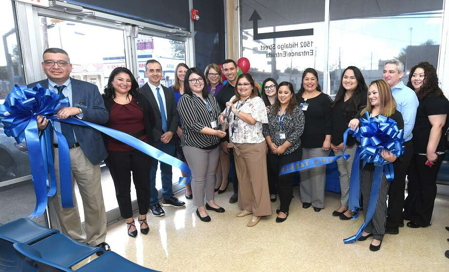 Officials and staff of Grifols Biomat USA Plasma Center downtown location, gather for the center's 20th anniversary ribbon cutting, Monday, Sep. 16, 2019. Photo: Danny Zaragoza, Laredo Morning Times