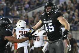 EVANSTON, IL- SEPTEMBER 16: Nathan Fox #45 of the Northwestern Wildcats celebrates a tackle against the Bowling Green Falcons with Austin Hiller #25 during the first half on September 16, 2017 at Ryan Field in Evanston, Illinois. (Photo by David Banks/Getty Images)