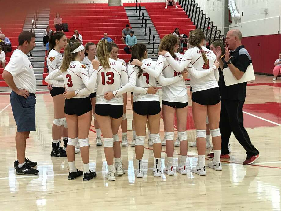 Coach Steve Lapham, far right, addresses the Greenwich High volleyball team after the first game of their match against Ridgefield on Monday, September 16, 2019, in Greenwich. Photo: David Fierro / Hearst Connecticut Media
