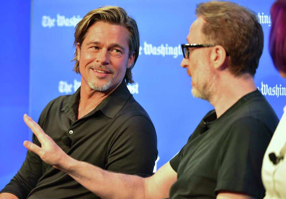 """Brad Pitt, left, and director James Gray talk """"Ad Astra"""" with NASA officials during a Washington Post Live event on Sept. 16, 2019. Photo: Washington Post Photo By Ricky Carioti / The Washington Post"""