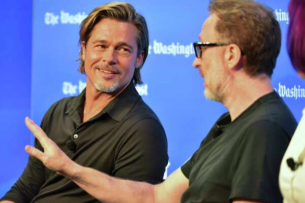 """Brad Pitt, left, and director James Gray talk """"Ad Astra"""" with NASA officials during a Washington Post Live event on Sept. 16, 2019."""