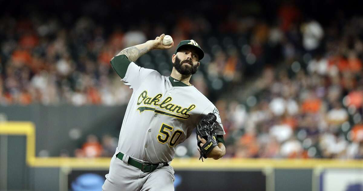 Oakland Athletics starting pitcher Mike Fiers throws against the Houston Astros during the first inning of a baseball game Monday, Sept. 9, 2019, in Houston. (AP Photo/David J. Phillip)