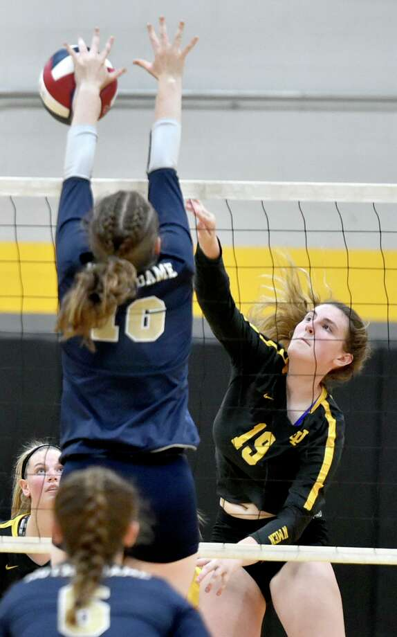 Milford, Connecticut - Monday, September 16, 2019: Alexis Neider of Jonathan Law H.S., right, spikes the ball against Rose Baker of Notre Dame H.S. of Fairfield Monday at Law H.S. in Milford. Photo: Peter Hvizdak / Hearst Connecticut Media / New Haven Register