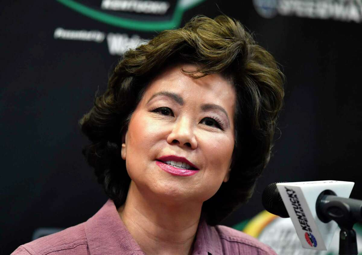 FILE - In this July 13, 2019, file photo, Transportation Secretary Elaine Chao addresses the media before the NASCAR series auto race at Kentucky Speedway in Sparta, Ky. The House Oversight Committee says it is investigating whether Chao acted improperly to benefit herself or her familya€™s shipping company. (AP Photo/Timothy D. Easley, File)