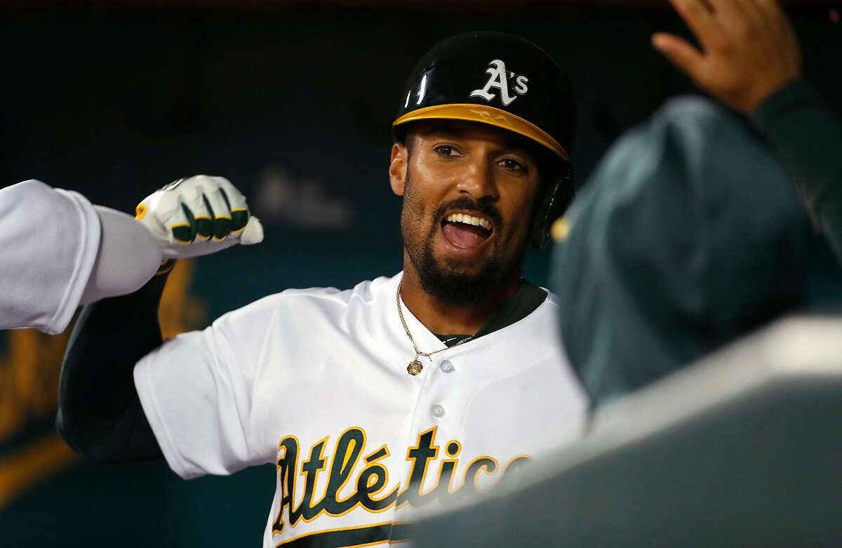 Oakland Athletics' Marcus Semien reacts to his 2-run home run in 2nd inning against Kansas City Royals during MLB game at Oakland Coliseum in Oakland, Calif., on Monday, September 16, 2019.