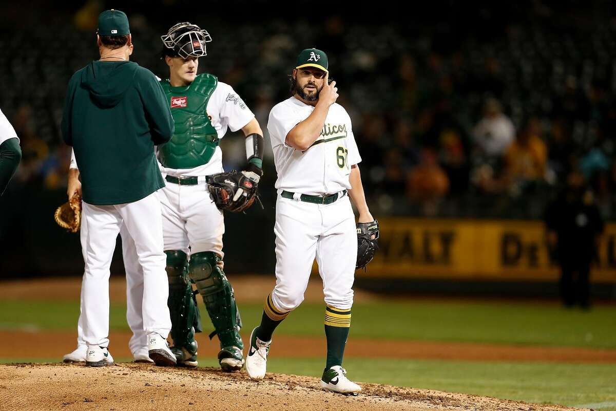 Oakland Athletics' starting pitcher Tanner Roark is removed in 5th inning against Kansas City Royals during MLB game at Oakland Coliseum in Oakland, Calif., on Monday, September 16, 2019.