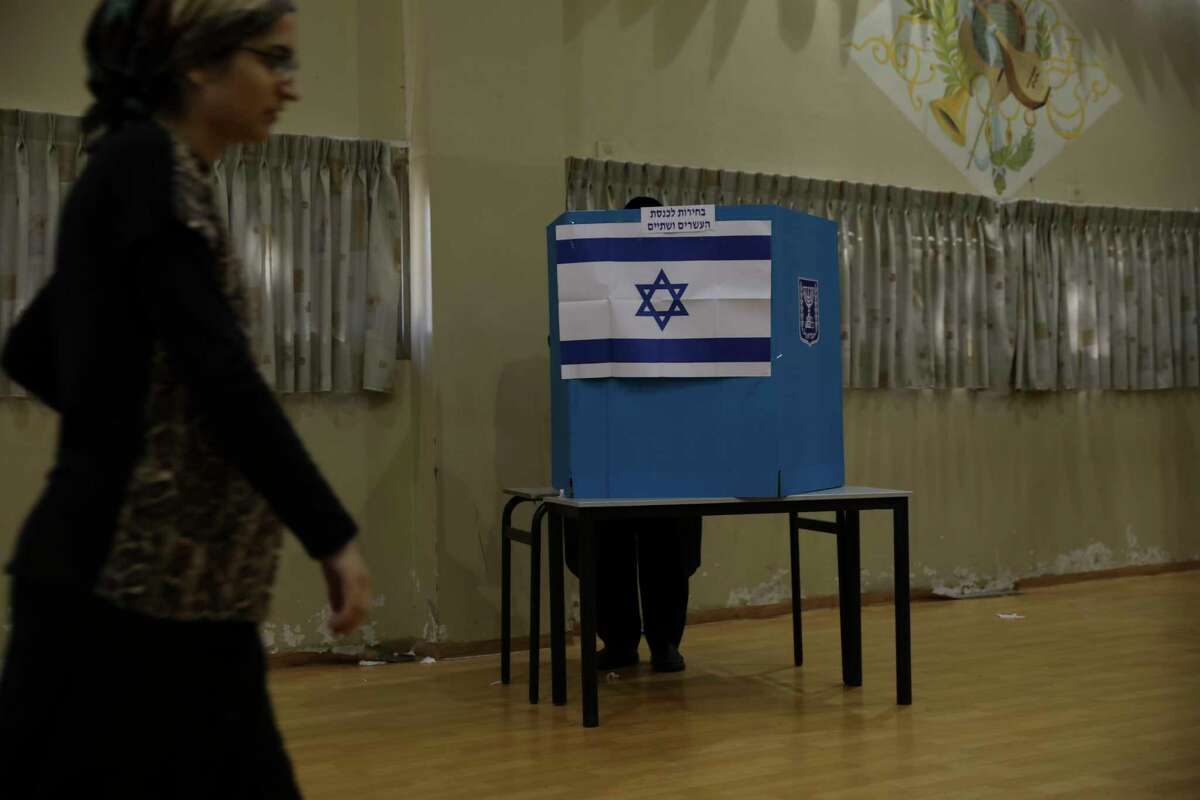 A man votes in Bnei Brak, Israel, Tuesday, Sept. 17, 2019. Israelis began voting Tuesday in an unprecedented repeat election that will decide whether longtime Prime Minister Benjamin Netanyahu stays in power despite a looming indictment on corruption charges. .
