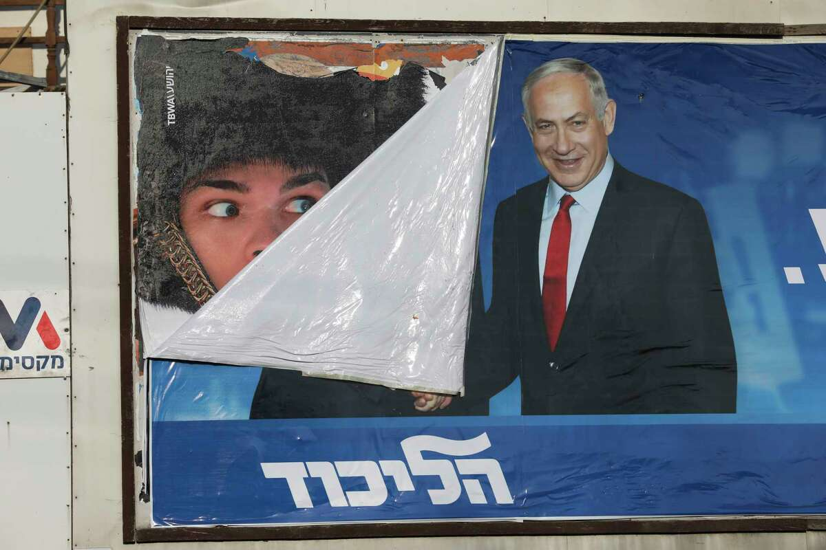 A campaign poster for Israeli Prime Minister Benjamin Netanyahu is seen in Bnei Brak, Israel, Tuesday, Sept. 17, 2019. Israelis began voting Tuesday in an unprecedented repeat election that will decide whether longtime Prime Minister Benjamin Netanyahu stays in power despite a looming indictment on corruption charges. .