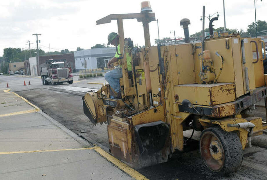 Mark Moeller of K.E. Vas Co. rotomills part of South Mauvaisterre Street on Monday. The work is part of a resurfacing plan approved by Jacksonville's City Council for several downtown streets. Photo: Marco Cartolano | Journal-Courier