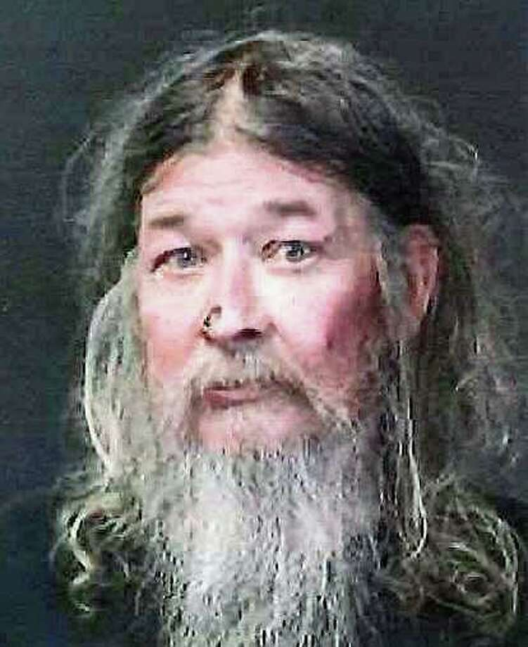 A Connecticut man was charged with cruelty to persons on Monday, Sept. 16, 2019 after State Police found his mother living in deplorable conditions under his care at the family home in February, according to an arrest warrant. James Madsen, 64, of Clayton Road, North Canaan, was held overnight on $50,000 bond after being taken into custody. Madsen was one of the primary caregivers for his 85-year-old mother, Catherine Madsen, who family members said wanted to die at home, according to an arrest warrant. Photo: State Police Photo