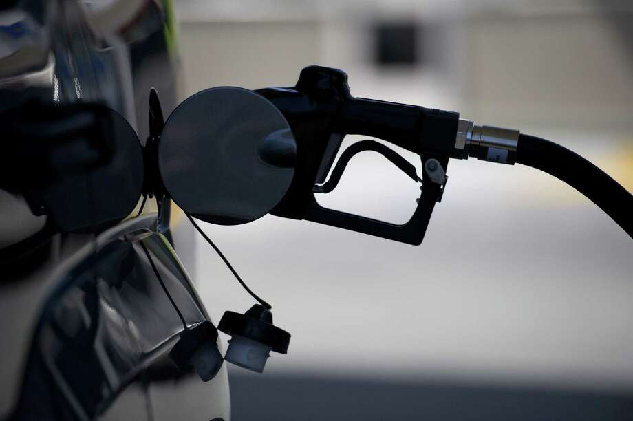 A gasoline nozzle is inserted into a car at a gas station in San Francisco on April 6, 2012. Photo: Bloomberg Photo By David Paul Morris. / 2012 Bloomberg Finance LP