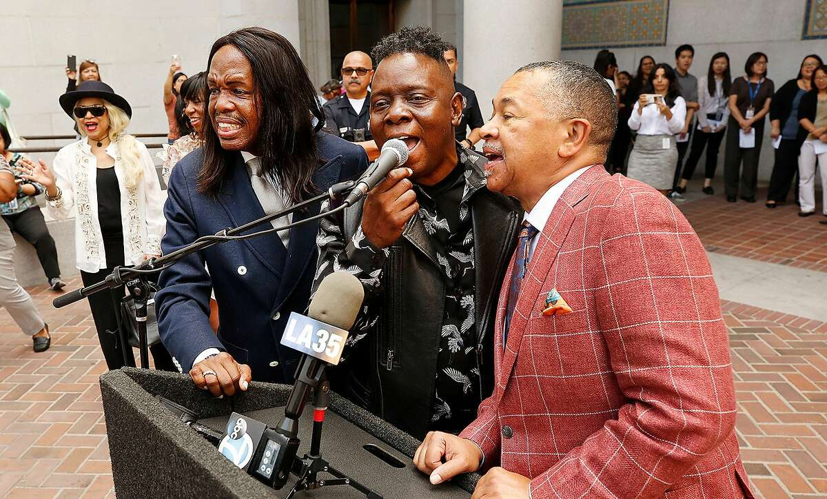 The three principal members of the famous music group Earth Wind and Fire, from left to right, Verdine White, Philip Bailey and Ralph Johnson, sing to the crowd as they visit Los Angeles City Hall where the band had a celebration regarding the establishment of EWF Day in Los Angeles that is pegged to the band's upcoming Hollywood Bowl shows and Kennedy Center Honors on Sept. 10, 2019. (Al Seib/Los Angeles Times/TNS)